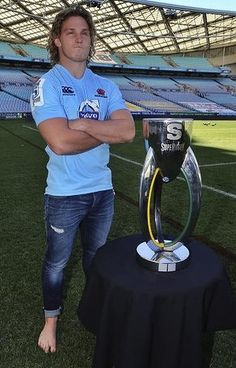 On his lonesome . Michael Hooper with the Super Rugby trophy. Michael Hooper, Super Rugby, Athletic Supporter, Rugby League, Man Stuff, Candid, Champion, Football, American Football