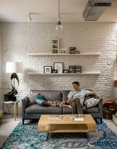 Modern living room in Brooklyn with exposed brick wall