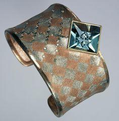 Red gold and platinum bracelet with diamonds and aquamarine.