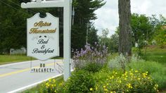 The welcoming sign at The Alpine Homestead Bed and Breakfast