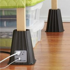 """Use bed risers to free up that much needed under-bed storage space. These Power Bed Risers from Bed, Bath & Beyond not only lift your bed an extra 8"""", they provide you with a pair of both grounded outlets and USB outlets. From Our Design Connection, Inc. Blog 