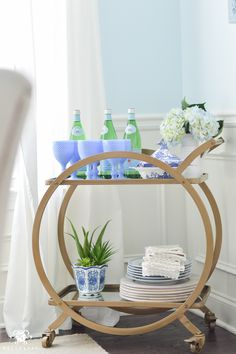 Shades of Summer Home Tour with Neutrals and Naturals- world market asher bar cart in blue dining room