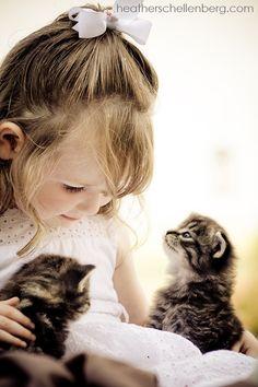 Cute little girl with her 2 adorable tabby kittens (hva)