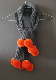 grey scarf with orange poms