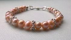 Peach cultured pearl bracelet £15.00