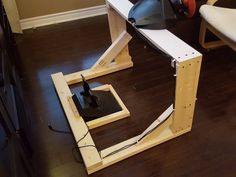DIY Steering Wheel Stand I play a fair amount of racing games, and have always preferred to use a wheel instead of a controller. In a fit of creativity a few months back, after purchasing… Playstation, Xbox, Ps4, Racing Seats, Racing Wheel, Ikea Poang Chair, Cool Kids Rooms, Racing Simulator, Table Games