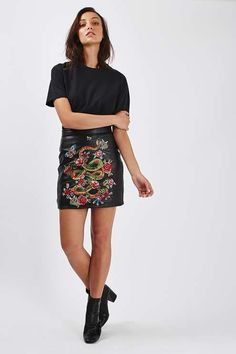 It's all about embroidery this season, and this time we're seeing it on leather. This skirt, complete with floral and butterfly details, strikes the perfect balance between edgy and feminine. Wear with a baggy tee and some ankle boots.  #Topshop