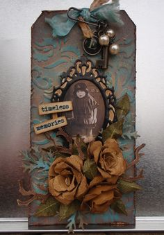 vintage tag       manila tag embossed using 'craft concepts' venus.   raised detail highlighted with acrylic,  then  antiqued  with  'd...