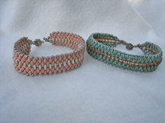 These bracelets are a free pattern from Whim Beads called Parallel Paths. It uses two hole lentil beads. I added an extra row of super duos to give the bracelet more substance, and did not use picots at the edges.