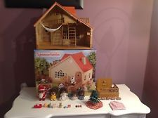 Sylvanian Families log cabin with the hedgehog family, Bear, and accessories