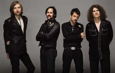 THE KILLERS  Its a nice picture until U get to Dave...he looks like he's wearing his pajamas with eyeliner...WHAT???
