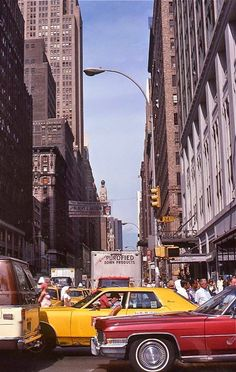 34th Street and 7th Avenue facing North, 1977. Photo by Laura Knight.  Color Photographs of New York City in the 1970s