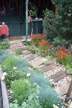 Pretty for a prayer garden ***planks of wood every so often.  Pretty!