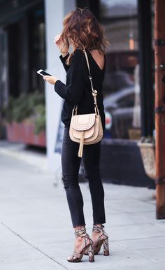 Break up an all black outfit with a pair of statement print platforms like this gorgeous faux snakeskin pair by Gucci. Erica Hoida looks ultra chic in this outfit consisting of distressed jeans, a knit sweater and a cute beige mini bag which provides...