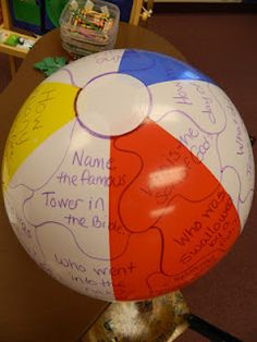 """Different way of dividing ball for questions. How to play Review Game.  I gently toss the beach ball to one of my Kids.  When they catch the ball I will say, """"Right Hand"""" or """"Left Hand.""""  Whatever question their corresponding hand is on is the question I will ask them.  Then they toss the beach ball back to me."""