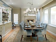 I love the upholstery on these dining chairs...with the studded trim. Candice Olson design of course!