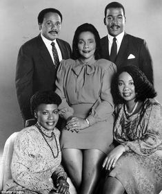 Portrait of Civil Rights activist Coretta Scott King (center) as she poses with…