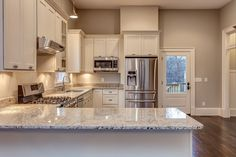 Photo gallery of remodeled kitchen features CliqStudios Dayton Painted White…