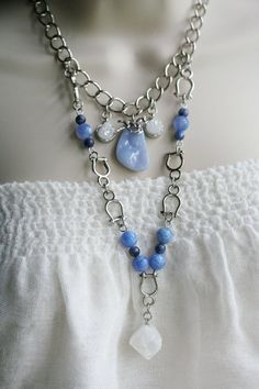 Made with Druzy Quartz, Blue Chalcedony, Blue Crackled Fire Agate and Sodalite. The energies of these gemstones with the Horse Totem, bring you the strength to let your inner light shine. They purify and amplify the body's natural healing properties, provide balance to the emotions, open blockages, assist you in connecting with your higher power, facilitate acceptance, bring peace, deepen spiritual understanding and allow your unique creative expression to flow.