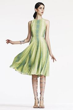 Lyn Devon Spring 2012 collection. Green on green printed sleeveless dress with jewel neckline and flowing skirt. Charming!
