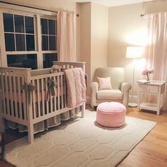 Pink baby girl's nursery! Pink decor with pouf and grey crib!