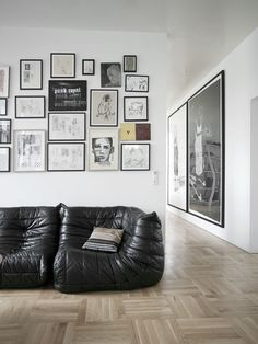 quadros na parede : tudo do mesmo tom e com molduras semelhantes. O efeito ficou minimalista na medida certa!