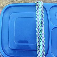 Rainbow Loom - use a headband pattern to secure your LunchBox!  A great idea from rachelsrandom.com blog.  #MichaelsRainbowLoom