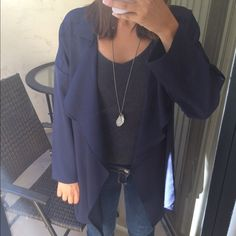 Long Navy Coat So cute and comfy. I love the way this coat hangs down when worn. Lightweight. Loose fitting. Sleeves can be worn up or down. Polyester and cotton blend. Does not button or zip. Meant to be worn open. I am 5'3 and a size 2. This item is available. Check out my sales in the last picture ❤️ Jackets & Coats Trench Coats