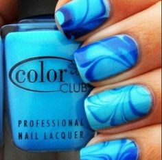 Swirls made with blue nail polish! This is so easy to do with the use of a toothpick!