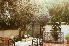 Brick patios add instant charm to outdoor spaces. Whether you use actual bricks or brick pavers, the result is a neat arrangement of pieces to create the perfect setting for… Outdoor Rooms, Outdoor Gardens, Outdoor Furniture Sets, Outdoor Retreat, Backyard Retreat, Metal Furniture, Patio Dining, Outdoor Dining, Outdoor Decor