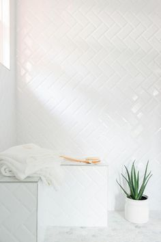Master Bathroom From HGTV Dream Home 2016 - An inexpensive alternative to more pricey tiles, simple subway tiles were installed in a herringbone pattern in the shower. White grout between the tiles lends a more cohesive look. White Subway Tile Bathroom, Bathroom Pictures, Master Shower, Modern White Bathroom, Subway Tile Patterns, White Bathroom, Bathrooms Remodel, Bathroom Decor, Bathroom Inspiration