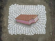 The Chicago artist is on a mission: patching up his city's broken pavement by filling potholes with colorful works of art