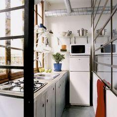 le petite cusine! Love the narrow kitchen, skiny fridge, with the microwave on top, and ikea shelfing. classic. Parfait!