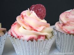 White Chocolate Raspberry Cheesecake Cupcakes with a raspberry cream cheese frosting...oh man