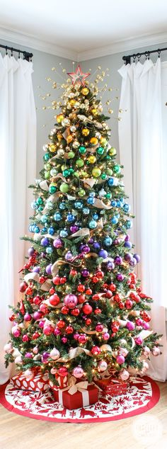 A Colorful Christmas Tree Idea, plus you can make into Mardi Gras colors and have it up for 3 months!! Christmas 2017, Christmas Tree Colours, Themed Christmas Trees, Christmas Tree Baubles, Merry Christmas, Rainbow Christmas Tree, Christmas Balls, Artificial Christmas Trees, Holiday Tree