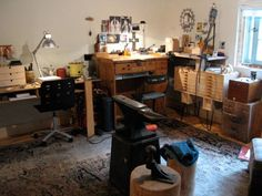 Lisa Havelin jewelry studio.  Wow!  I can't imagine having a rug in my studio.  It would get ruined!