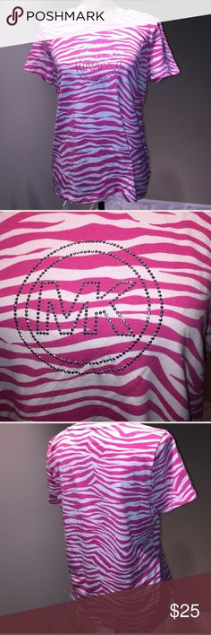"""Worn Once! Michael Kors animal print bling tee Worn Once! Michael Kors Pink and White animal print bling tee! Size large. Measurements are: shoulders 15.5"""", chest 19.5"""",  length 24.5"""". Super soft and comfy! From a smoke free home and ships in one business day, thank you! MICHAEL Michael Kors Tops Tees - Short Sleeve"""
