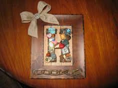 Made with scrapbook paper, wooden letter then put in frame....great gift idea :)  found old chain on the road!