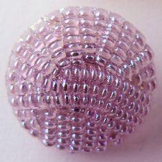Aurora luster transparent purple imitation fabric glass button.