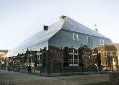 This shop and office complex by Dutch architects MVRDV is disguised as an old farmhouse, but its walls and roof are actually made from glass.