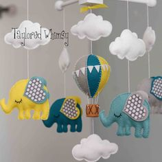 Elephant Mobile - Hot Air Balloon Mobile - Custom Mobile (not ready made) - Ships in 4-6 Weeks by TayloredWhimsy on Etsy https://www.etsy.com/listing/188957049/elephant-mobile-hot-air-balloon-mobile