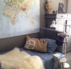 A bedroom with a big map, be still, my heart!