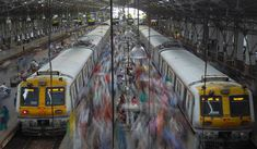 Commuters disembark from crowded suburban trains during the morning rush hour at Churchgate railway station on World Population Day in Mumbai July 11, 2012. By using a slow shutter speed the people rushing through the station are blurred giving the reader a feeling for the hustle and bustle. (Vivek Prakash/REUTERS)