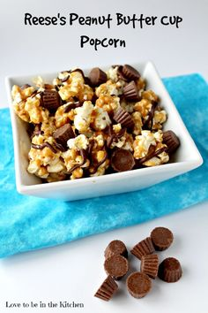 Reese's Peanut Butter Cup Popcorn- Peanut butter popcorn, drizzled with chocolate and topped with mini Reese's Peanut Butter Cups! Perfect for movie nights, game days, a snack or dessert! Simple to make and so delicious.