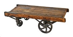 original late 19th century structurally sound and stable solid oak wood and cast iron towsley factory furniture cart or truck with sanded and sealed finish