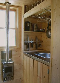 kinda dig this tiny kitchen idea for my camper More I received a note from a reader last week after my post on mobile dwelling designer Christopher Deam reminding me of Tumbleweed, the Tiny House Company, founded by Jay Shafer, who builds and sells … House Plans, House Interior, Small Space Kitchen, Home, Tiny House Kitchen, House, Tumbleweed House, Tiny Spaces, Tiny Kitchen