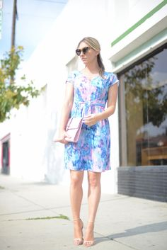 Spring perfection: pastel watercolor print dress paired with blush clutch & minimalist sandals.