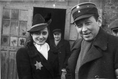 Lodz, Poland, Mrs. Eivoshitz and Mr. Rajngold, head of the economic section of the ghetto Jewish police and one of the directors of the food supply department, standing next to the entrance to supplies storeroom 2. Later on, Esther Eivoshitz was appointed head of the diet shops coupon department. In the diet shops, a supplementary supply of food was given to children, pregnant and breastfeeding women and sick people