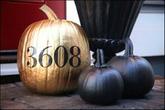 Fall/Halloween front porch/door ideas.  Inspiration.  Spray paint pumpkins black and gold; use a template (from 'Michael's or 'Hobby Lobby') to spray paint your adress or your last name, etc.  Neat idea.