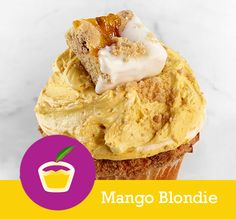 Mango Blondie CAKE Vanilla with White Chocolate Chips, Pecans & a Brown Sugar Top FILLING Caramelized Mango Mousse Cream TOPPING Caramelized Mango & Brown Sugar Buttercream Swirl with a White Chocolate Dipped Mango Blondie